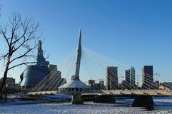 Over the Red River. Winter view on Esplanade Riel bridge with Canadian Museum for Human Rights on the background Stock Images