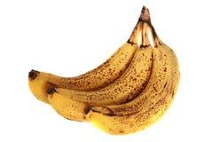 Over rijpe bananen die op witte achtergrond worden geïsoleerds Stock Foto