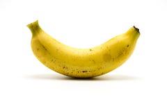 Over rijpe die banaan op witte achtergrond wordt geïsoleerd Royalty-vrije Stock Fotografie