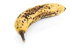 Over ripe banana isolated on white Stock Photos