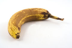 Over ripe bananna on white Royalty Free Stock Photography