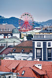 Over the Roofs of Linz. Ferris Wheel over the Roofs of Linz, Austria Royalty Free Stock Photography