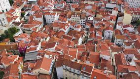 Over the rooftops of Lisbon on Alfama hill - CITY OF LISBON, PORTUGAL - NOVEMBER 5, 2019 stock video footage