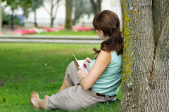Over should look of young attractive fresh woman at the park wri Stock Photo