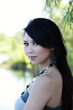 Over the shoulder portrait young Asian woman. Outdoor portrait of young Asian American woman Royalty Free Stock Images