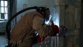 Over shoulder shoot on craftsman welding stock video footage