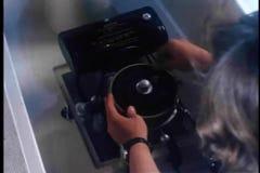 Over the shoulder shot of man starting up motor boat engine stock video