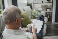 Senior Reading The Newspaper Royalty Free Stock Photo