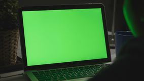 Over the shoulder shot of a young boy using on laptop computer on desk, stock video footage
