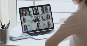 Business woman remote worker video conferencing colleagues by group videocall
