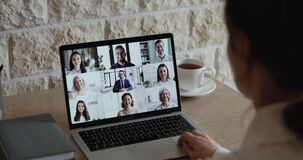 Free Over Shoulder View Of Employee Communicating With Team By Webcam Stock Photos - 181530453