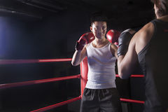 Over the shoulder view of two male boxers getting ready to box in the boxing ring in Beijing, China Royalty Free Stock Image