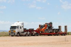 Over Size heavy transport by freight trailer, a road train in Australia Stock Photography