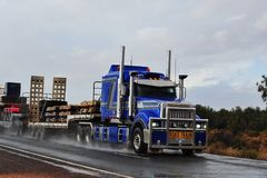 Blue truck carrying Manganese, with storm approaching. royalty free stock images