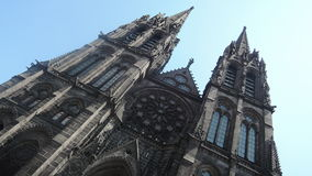 Over the sky. Cathedral in Clermont-Ferrand, France Royalty Free Stock Images