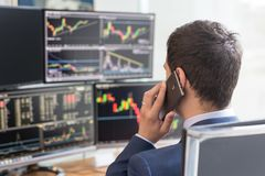 Free Over The Shoulder View Of Computer Screens And Stock Broker Trading Online. Royalty Free Stock Photos - 107056428