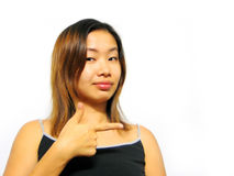 Over There!. An asian girl pointing sideways stock photography