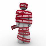 Over-Thinker Man Wrapped in Tape Too Much Analysis Paralysis. Over-Thinker words on red taped wrapped around a man or person immobilized by analysis paralysis Royalty Free Stock Photo