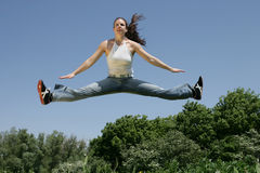 Over the top. Girl jumping and having fun in the spring Stock Image