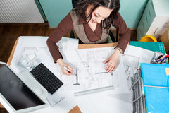 Over top view of architect working at her desk Stock Images