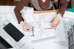 Over top view of architect working at her desk Royalty Free Stock Photo