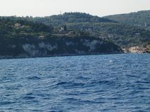 View over the blue water on the rocky coast of Antipaxos in Greece royalty free stock images