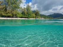 Over under beach shore sandy seabed Huahine island stock photography