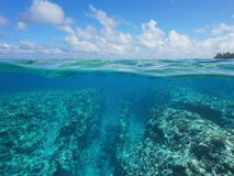 Free Over Under Rocky Seabed Coral And Cloudy Blue Sky Stock Photography - 92206402