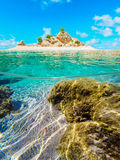 Over and under water surface of a tropical atoll Royalty Free Stock Images