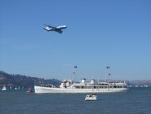 777 Over The USS Potamic. Jumbo Jet Buzzing The USS Potamic Royalty Free Stock Photo