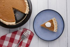 Over view of a plate of pumpkin pie stock images