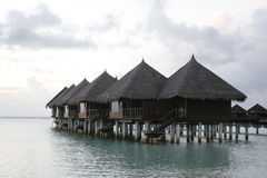 Over Water Bungalow. Bungalows are standing over sea water Royalty Free Stock Photos
