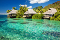 Over water bungalow with steps into amazing lagoon stock photography