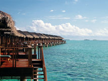 Over water bungalow with steps into amazing lagoon Royalty Free Stock Images