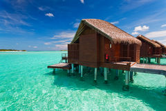 Over water bungalow with steps into lagoon. Over water bungalow with steps into amazing lagoon Royalty Free Stock Photo