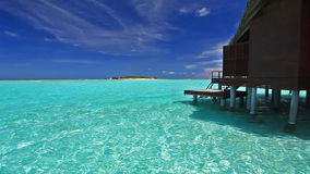 Over water bungalow with steps into lagoon. Over water bungalow with steps into blue lagoon stock video footage