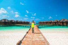 Over water bungalows with steps into amazing green lagoon. Maldives Stock Image