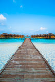Over water bungalows with steps into amazing green lagoon Stock Images