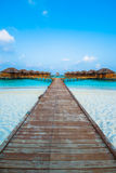 Over water bungalows with steps into amazing green lagoon Stock Photos