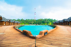 Over water bungalows with steps into amazing green lagoon Royalty Free Stock Photography