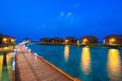 Over water bungalows with steps into amazing green lagoon Royalty Free Stock Photo