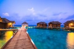 Over water bungalows with steps into amazing green lagoon Stock Image