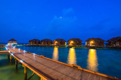 Over water bungalows with steps into amazing green lagoon. In South male atoll of Maldives Stock Photo