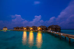 Over water bungalows with steps into amazing green lagoon Royalty Free Stock Image