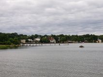 Over the water on a cloudy day. Rippling water on a cloudy summer day royalty free stock photography