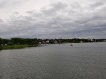 Over the water on a cloudy day. Rippling water on a cloudy summer day stock photography