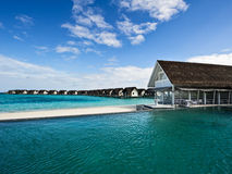 Over water house and swimming pool in beach resort royalty free stock photos