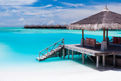 Over water jetty with steps into tropical lagoon Royalty Free Stock Photography