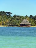 Over the water restaurant with thatched roof Stock Photos