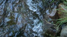 Over water between stones Creek. Over water between and stones Creek stock footage